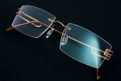 Eyeglasses. Elegant eyeglasses on a dark background Stock Image