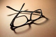 Eyeglasses. Pair of Eyeglasses on Warm Background Royalty Free Stock Photo