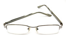 Eyeglasses. A pair of eyeglasses on white background Stock Photo
