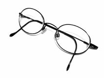 Eyeglasses. Pair of Eyeglasses on white Stock Photos