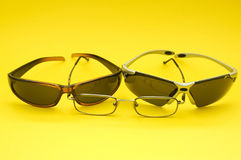 Eyeglasses. Different kind of eyeglasses isolated on yellow royalty free stock images