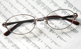 Eyeglasses on account document Stock Photo
