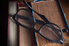 Eyeglasses on antique books Royalty Free Stock Photography