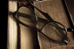 Eyeglasses on antique books Stock Images