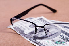 Eyeglasses on Banknotes Royalty Free Stock Photography