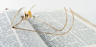 Eyeglasses and Bible. Eyeglasses Laying on the Bible Ready to Resume royalty free stock photos