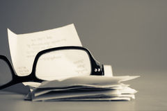 Eyeglasses and bills Royalty Free Stock Images