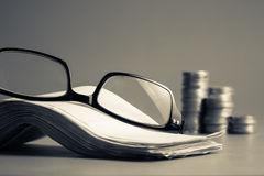 Eyeglasses and bills Royalty Free Stock Image