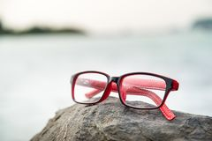 Eyeglasses with blured sea in background. Royalty Free Stock Image