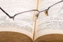 Eyeglasses on a book Royalty Free Stock Image