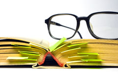 Eyeglasses and book Stock Photo