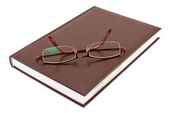 Eyeglasses and book Royalty Free Stock Images
