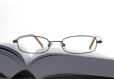 Eyeglasses with book Stock Photo
