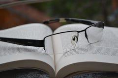 Eyeglasses on book Stock Photos
