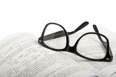 Eyeglasses on book Stock Image