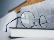 Eyeglasses and book in bedroom for reading and relax. royalty free stock image