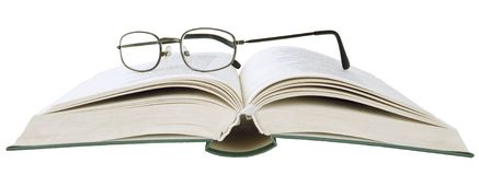 Eyeglasses on book isolated objects Royalty Free Stock Photo
