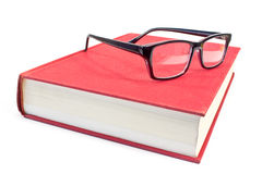 Eyeglasses and book Stock Images