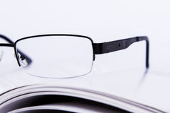 Eyeglasses on Book Stock Photos