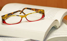 Eyeglasses and book. A pair of eyeglasses on a book Stock Image