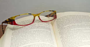 Eyeglasses on book. A pair of eyeglasses on a book Royalty Free Stock Image