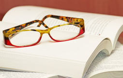 Eyeglasses on a book Stock Image