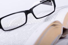 Eyeglasses and book Stock Photos