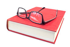 Eyeglasses and book Stock Image