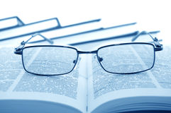 Eyeglasses on books Stock Photos
