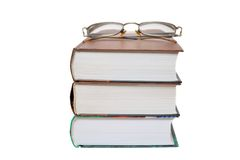 Eyeglasses on the books Stock Images