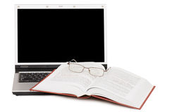 Eyeglasses and books on the laptop Royalty Free Stock Photo
