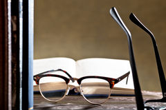 Eyeglasses with books Stock Images