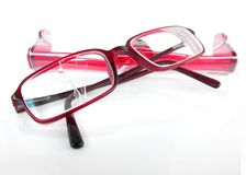 Eyeglasses with broken lens Stock Photos