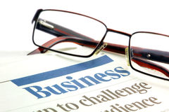 Eyeglasses on a business papers Royalty Free Stock Image
