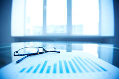 Eyeglasses on business report Royalty Free Stock Photo