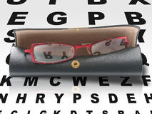 Eyeglasses in case on eye chart Stock Image