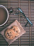Eyeglasses Chocolate Chip Cookies and Mug on Table Stock Photography