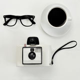 Eyeglasses, coffee and instant camera Royalty Free Stock Image
