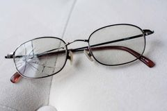 Eyeglasses with cracked lens Stock Image