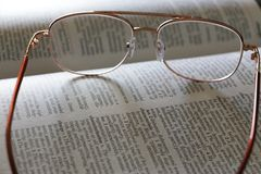 Eyeglasses on a dictionary Royalty Free Stock Images