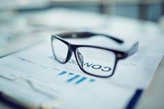 Eyeglasses on document Stock Photography