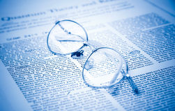 Eyeglasses on a document closeup Royalty Free Stock Photo