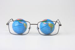 Eyeglasses of the Earth. Globe Stock Photography