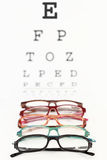Eyeglasses on an eye chart Royalty Free Stock Photo