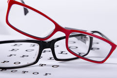Eyeglasses and eye chart Stock Photos