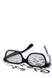 Eyeglasses on a eye exam chart Stock Photos