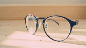 Eyeglasses on the floor. Stock Photo