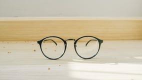 Eyeglasses on the floor. Stock Photos