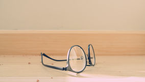Eyeglasses on the floor. Stock Photography