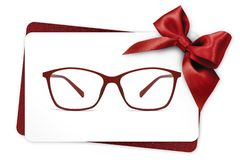 Eyeglasses gift card, red spectacles and red ribbon bow, isolate royalty free stock photos